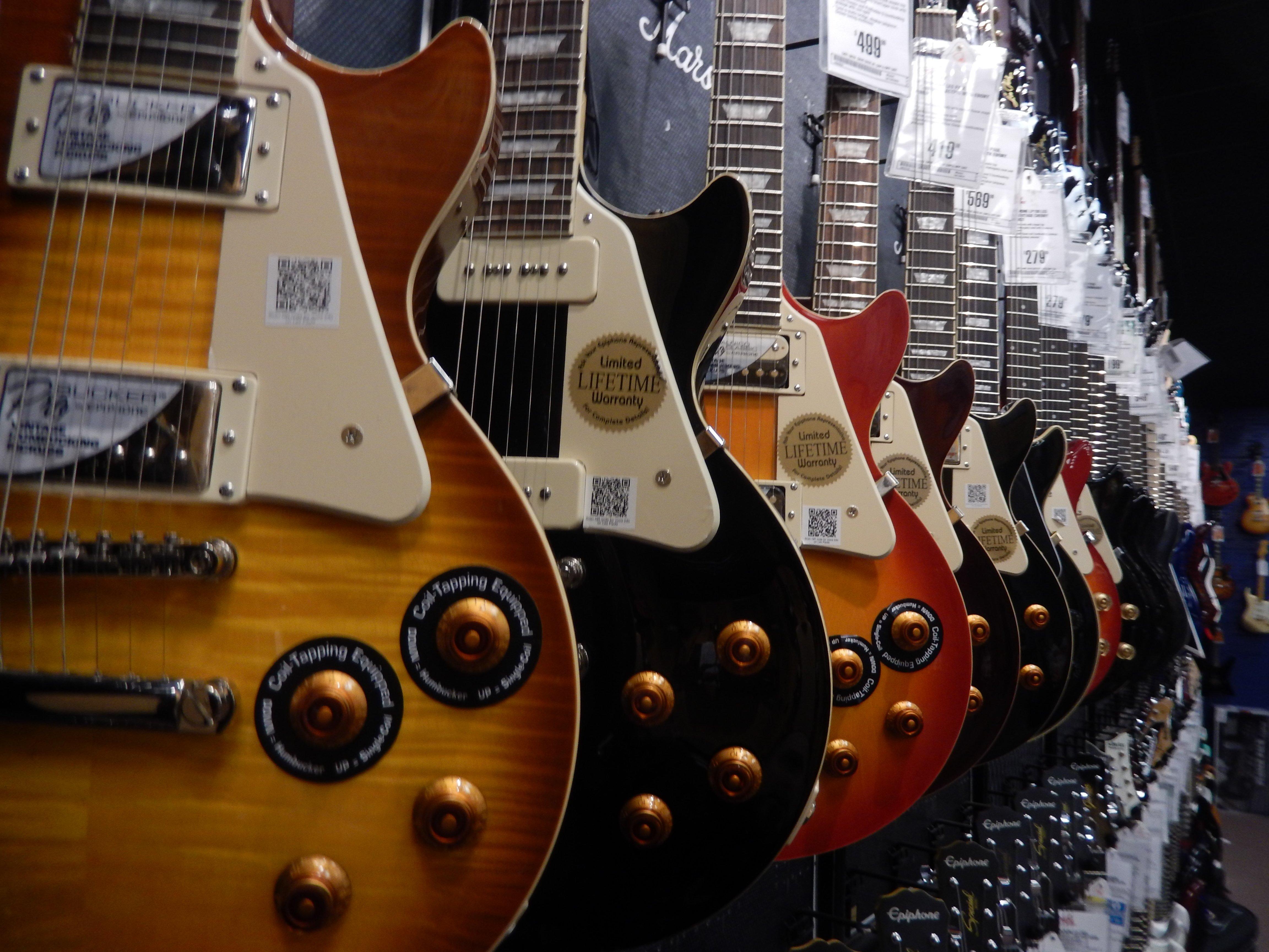 Closeup of walls of guitars of Guitar Center in Cedar Rapids, IA