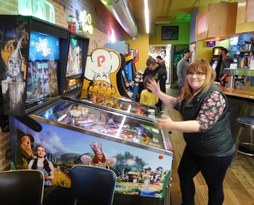 Jessica Bertling loses her ball playing Wizard of Oz pinball machine in Iowa City, IA.