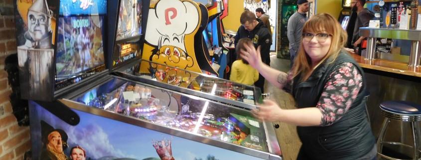 Jessica Bertling loses her ball playing Wizard of Oz pinball machine in Iowa City, IA.