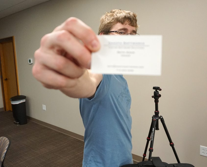 Seth Adam holding his business card. He does great work!