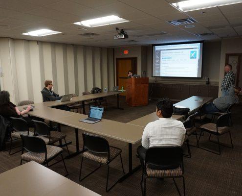 Michele Saba showing us her website at the WordPress meetup group in Cedar Rapids, Iowa. Photo by Big Ten Web Design