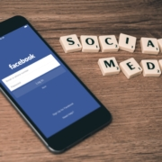 Log into Facebook screen on phone with Social Media spelled out in letters