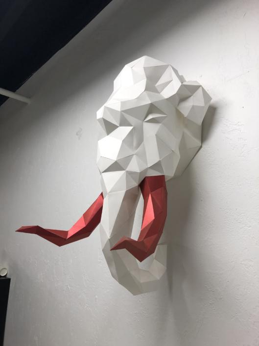 Cut paper wall art at Yoimono - Coworking Space for Creatives in Cedar Rapids, IA